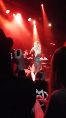 Jojo giving a lap dance during a concert