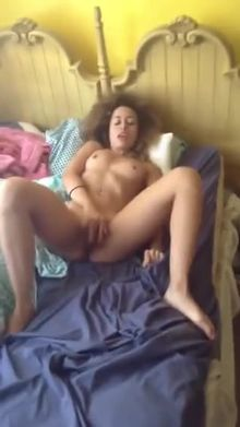 Sensual beauty pleasing herself in bed
