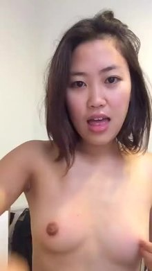 Cute Thai showing breasts and blowing kisses