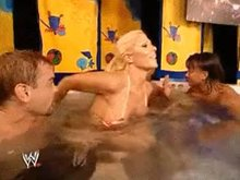 Torrie gets out of the jacuzzi