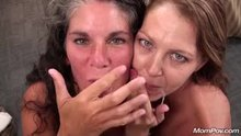 Two milfs smiling enjoying the taste of cum!