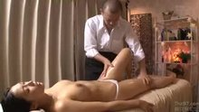 Getting fucked by the masseur next to her husband